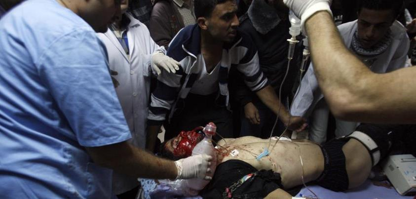 #Gaza Under Attack, Nov. 10, 2012 (102 photos)Palestinians bring a wounded man to a hospital in Gaza City, Saturday, Nov. 10,2012. An explosion targeted an Israeli military vehicle on the Jewish state's border with Gaza on Saturday and Israeli troops fired into the Palestinian territory, killing several civilians and wounding at least 25, among them children, Gaza officials and witnesses said. Ashraf al-Kidra, a Gaza health ministry spokesman, said four Palestinians killed were civilians between the ages of 16 and 18. (AP Photo/Hatem Moussa)