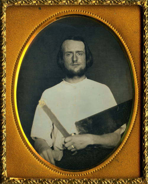 ca. 1850's, [daguerreotype portrait of a carpenter holding his crosscut saw & gold tipped T-square] via Ebay