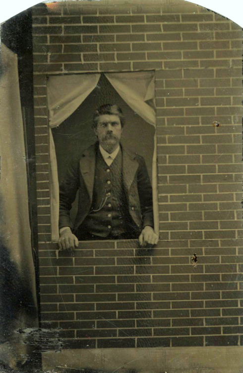 ca. 1860's, [tintype portrait of a gentlemen peering from behind a studio window prop] via Ebay