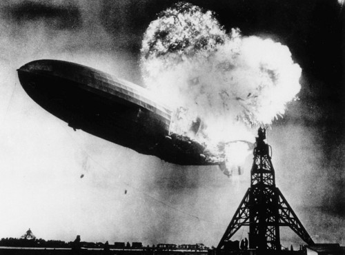 The massive German airship, the Hindenburg caught fire while attempting to land near Lakehurst, New Jersey, killing 35 people aboard, plus one ground crew member. Of the 97 passengers and crew members on board, 62 managed to survive. May 6, 1937.