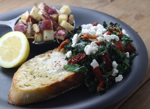"Egg-In-A-Hole with Sauteed Kale, Sundried Tomatoes & Goat Cheese There are a few different name variations for ""egg-in-a-hole"" : Egg in a basket; Bird's Nest; Frog in a Hole; Moon Eggs; Gas House Eggs.. the list goes on.  What did you call it growing up?  1 slice good Bread1 Egg1/4 cup Sundried Tomatoes, chopped3 cups fresh Kale, stems removed, leaves choppedJuice from 1/2 Lemon2 Tbsp Crumbled Goat CheeseSalt & Pepper to taste1/2 Tbsp Extra Virgin Olive Oil1 Tbsp Butter  In a sautee pan, heat olive oil.  Add kale and toss.  Salt & pepper to taste.  As you continue to cook the kale on low/medium heat, melt butter in another sautee pan.  Cut a round circle in your slice of bread and add to the pan.  As it's browning, crack an egg into the ""hole"" in the middle.  Salt & pepper to taste.  Add sundried tomatoes to the sauteed kale and toss.  After a minute or to (or whenever the egg starts to firm) gently flip the egg-in-a-hole to cook the other side.  The goal is not to break the yoke, so take your time.   Let the other side of the egg firm up a little before removing from heat.  Place on a plate, with the yolk side up.   Squeeze lemon juice onto kale & tomato mixture and make sure it's seasoned to your liking with salt & pepper.  Spoon kale mixture onto the egg-in-a-hole and sprinkle with goat cheese.  Serve hot.   I'm headed out to LA on Wednesday to visit some friends for a few days and though we have some plans already (Disneyland!!), I would love any advice on where to eat, drink and explore.  I haven't been to that area since I was a kid, so I have zero idea of what to expect… perhaps I can recreate this 20 years later:  If you have advice, please send me a tumblr message or email theboredvegetarian@gmail.com."