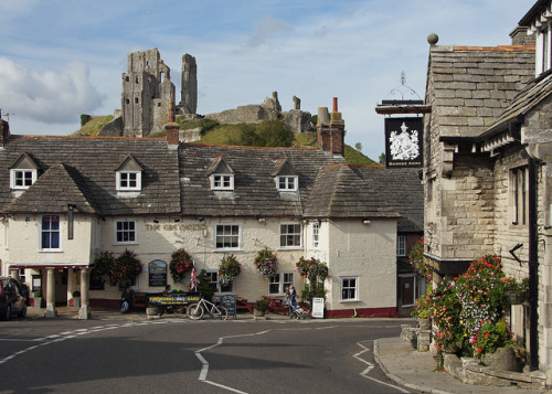 "just-wanna-travel:  Corfe Castle, England, UK  Every time I see a picture of corfe I get this little jolt, just because it's somewhere that I know and recognise. A little banner goes up in my brain with, ""I've been there!"" on it. I miss my home county very much."