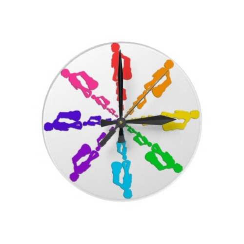 (via Rainbow D Wall Clocks from Zazzle.com)