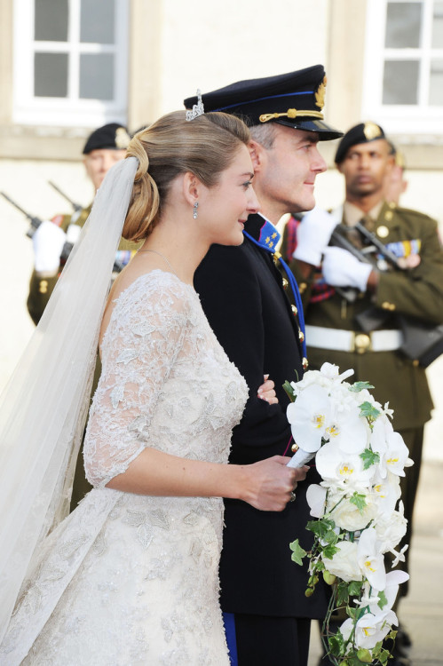 Princess Stephanie of Luxembourg ▬ The 28-year-old bride, wore an Elie Saab dress, with a four-metre (13 feet) train as walked down the aisle. What it Took to Make her dress: 50 metres of Chantilly lace.40 metres of Calais lace.30 metres or satin organza.70 metres of tulle and silk crepe for the lining.15 metres of silk tulle for the veil.200 pieces of transparent glitter.80,000 transparent crystals.50,000 beads/pearls.10,000 metres of silver embroidery thread. (source: theroyalcouturier)