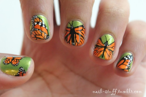 nail-stuff:  Monarch butterfly nails!  I cut my nails as short as I possibly could in response to a message I got asking about nail designs for really short nails. For the background I used Ivy League by Sally Hansen