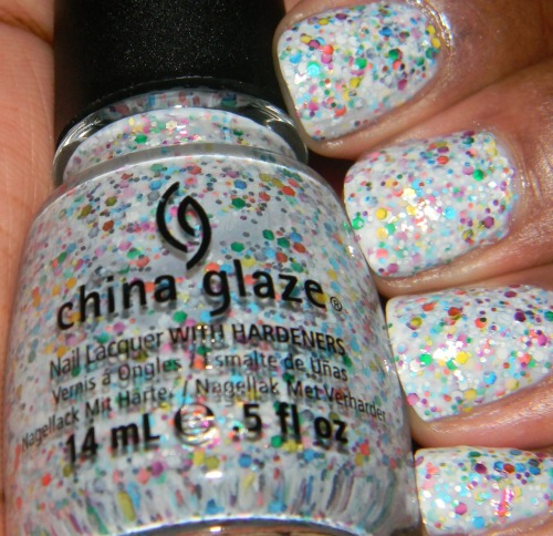 China Glaze - It'a A Trap-Eze! from the Cirque du Soleil Collection Multi colored and sized glitter in a milky white base. Isn't she beautiful? It's A Trap-Eze! is hands down the best from this collection. There are similar indies out there but nothing compares to this. Photo shown is 3 coats with top coat. Fin.