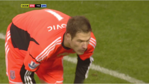 Asmir Begović is sad because he's got to bend down so far to see Tony Pulis' face under his cap.