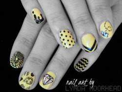 Black and yellow mix… I think the bee nail is my favourite.