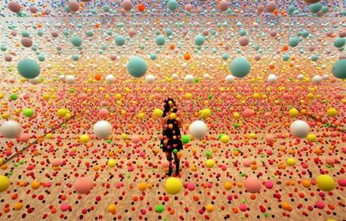 Nike Savvas, Atomix - Full of Love, Full of Wonder.  Australian artist Nike Savvas makes final adjustments to her art piece consisting of over 50,000 polystyrene balls at the New South Wales Art Gallery in Sydney, August 3, 2006.   Via: REUTERS/David Gray