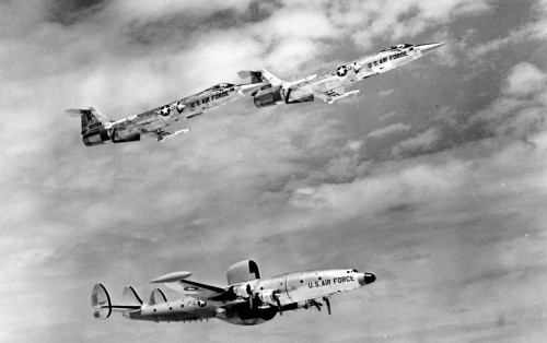 Lockheed F-104A-15-LO (S/N 56-0769 and 56-0781) in flight with Lockheed EC-121 (S/N 55-0127).  Photo: U.S. Air Force.