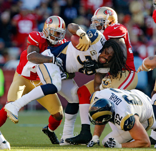 Rams RB Steven Jackson loses his helmet as he is gang-tackled by cornerback Chris Culliver (No. 29) and linebacker Patrick Willis during Sunday's matchup between the NFC West rivals. The teams ended up in a 24-24 tie, the first tie in the NFL in four years. (Brian Bahr/Getty Images) KING MMQB: Thoughts and observations from Week 10BURKE: Reviewing the best and worst from Week 10