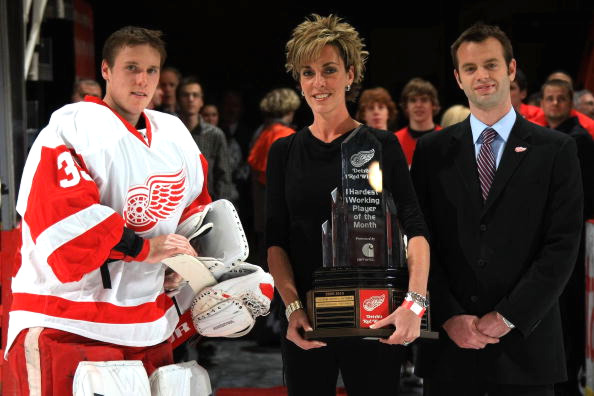 Doug Murphy, account executive for the Detroit Red Wings and Sanja Zerubica, event specialist for Carhatt present the 'Hardest Working Player of the Month' award to Jimmy Howard #35 of the Detroit Red Wings.