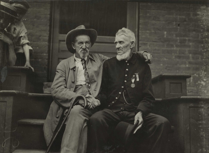 Two Civil War veterans from both sides shake hands at Gettysburg ca. 1913
