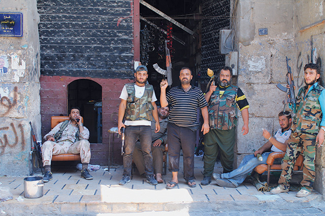 "I WENT TO SYRIA TO LEARN HOW TO BE A JOURNALIST  (AND FAILED MISERABLY AT IT WHILE ALMOST DYING A BUNCH OF TIMES)  Sunil Patel had never been published before he decided to go to Syria in August 2012 to become a war correspondent. Before his trip, the 25-year-old worked as a community-support officer for the London Police, lived with his mom and dad, and occasionally volunteered in Palestinian and Kurdish refugee camps. On one of his activist trips, Sunil befriended an ever so slightly more experienced freelance journalist from Canada who promised to take him into parts of Syria that were almost impossible for a foreigner to get to through legal routes. It was a foolish idea for sure, and he almost died several times during his trip, but we still think his story was worth the risk. And no, VICE did not send him there. He did this of his own accord, and we found out about it after the fact. Imet Carlos in an internet café in Erbil, in Iraqi Kurdistan (and, obviously, ""Carlos"" is not his real name). I overheard him talking about something involving Palestine and Syria over a Skype call, and when he had finished we struck up a conversation. Carlos told me that he'd already been to Syria, shooting as a freelance photographer, and that he was going back soon. I told him how I'd been thinking about going there to write about the conflict, but that I didn't have any experience as a journalist. ""You know what?"" he said. ""I'll take you to Syria."" He didn't seem to mind that I was a novice. That night, Carlos crashed at my hostel. He didn't have his own place to stay or money for a room, so he slept on the floor. It was a bit dodgy sneaking him in, but worth it, because we spent the whole night talking about Syria. I got the impression that Carlos wanted someone to travel with. I already had a ticket home to London, but we came up with an arrangement: I would fly back, and when Carlos was ready to return to Syria he would call me and we'd meet up in Turkey. From there, Carlos explained, we could cross the border. ""I've got contacts,"" he said. I was a little nervous, but this sounded like a good plan to me. We'd never have war reporters like Robert Fisk or Seymour Hersh if they'd stayed at home with their moms instead of going into the shit.Back in London, my parents were not too keen on my plans to travel to a country in the middle of a civil war. They thought I was going to get killed. My sister was really mad. I told them that I'd always wanted to be a war correspondent, and that if I ever was going to have a chance to become a real journalist, this was it. If people want news, somebody's got to go cover it. But they didn't care. They were upset.The very next day, Carlos called. ""Listen, man,"" he said. ""I'm going in. You coming or not?"" My mind was already made up. I told Carlos I'd meet him there and booked the next flight to Turkey.My plane landed in Istanbul, and then I took the bus to Hatay, where Carlos was staying with friends. The Syrian border is about 25 miles to the southeast. We wanted to get there as soon as possible, but neither of us spoke more than a few words of Turkish or Arabic. Luckily, we met a Turkish family who helped us get there. They took us into their home, gave us tea, and we ended up talking to them using Google Translate, typing words into their computer. We explained that we were trying to get to Syria. Somehow they understood and helped us call one of Carlos's contacts, who was supposed to meet us near the border to help us cross. We just had to get there.   At this point, Carlos promptly informed me that he was a veteran hitchhiker and had bummed rides all over Eastern Europe, so we decided to hitchhike to the Syrian border. We probably made a funny pair—I'm Indian, so I wasn't as suspect, but Carlos is a white guy with black hair and a camera slung around his neck. I don't know whether this made truck drivers more or less likely to pick us up, but we thumbed it all the way down the narrow two-lane road outside Hatay. It took us about seven rides with truck drivers and more than three hours to make it the 25 miles across the border. Carlos's contact, a guy named Muhammad, drove us the last few miles, into a town called Reyhanli near the Syrian border. One of the busiest border crossings between Turkey and Syria, Reyhanli is about 35 miles from Aleppo, where the war was really heating up. As we roamed around and tried to get oriented, loads of refugees were streaming into Turkey—to escape the war, I assumed. We walked across the border. No one stopped us or asked us any questions. We just walked right in. On the other side, more refugees milled around, waiting to cross into Turkey in cars and on foot. We didn't have an interpreter because we couldn't afford one. Carlos didn't have any more contacts, and at this point we were just hoping we'd see some rebels hanging around whom we could talk to and who would show us what war was like. Just then, some men in military uniforms came up to us. ""Journalist!"" they shouted in Arabic. ""Journalist!""""Yeah, we're journalists,"" I said, in English. I think they understood me. ""We want to get some coverage. Can you take us with you to the war?""  Keep Reading"