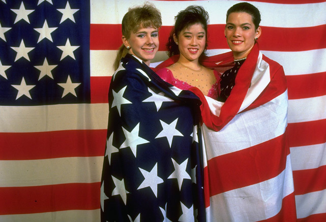 U.S. skaters Tonya Harding, Kristi Yamaguchi and Nancy Kerrigan pose during the 1991 World Figure Skating Championship. Harding, who reportedly took part in a 1994 attack on Kerrigan, turns 42 today. (Heinz Kluetmeier/SI) SI VAUL