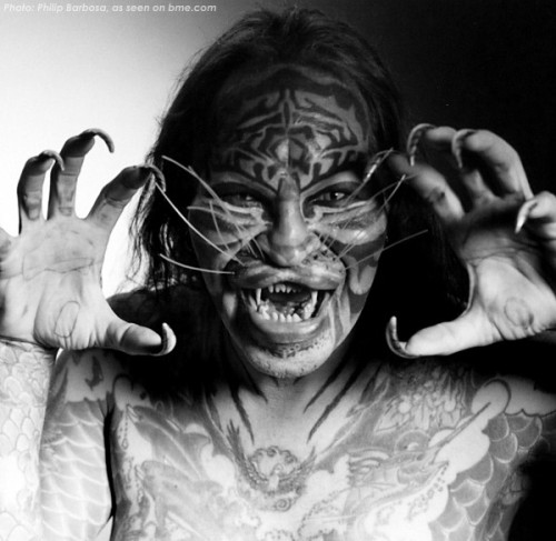 "joetisor:  RIP Stalking Cat  Dennis's boundary-breaking life was never an easy one, and as he was fond of saying, he ""found fame, but never fortune"". A wonderful and complex person, he was at times as troubled as he was remarkable, and he recently took his own life at the age of 54 (August 27, 1958 – November 5, 2012). This photo was taken at ModCon III by Philip Barbosa when Cat visited us here in Toronto. In the photo he appears with fellow concept transformation artist, Erik ""The Lizardman"" Sprague."