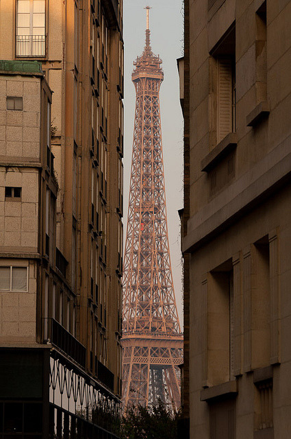 just-wanna-travel:  Paris, France  I remember seeing it for the first time. Just like in this photo - a tiny bit between other buildings. I'll never forget that feeling.