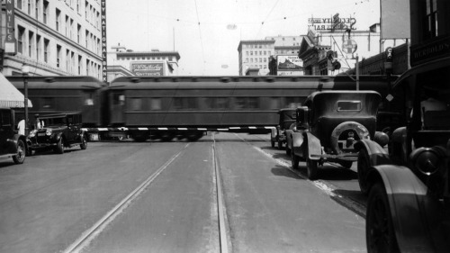 A Santa Fe Railway train crosses Colorado Street in what is now Old Town Pasadena, 1928. The at-grade crossing was later eliminated, and today the Metro Gold Line uses the old Santa Fe right-of-way. Part of the Automobile Club of Southern California Collection in the USC Digital Library.