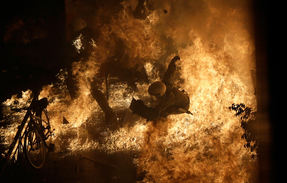 A riot police officer is engulfed by petrol bomb flames in front of parliament during clashes in Athens on November 7, 2012. —Dimitri Messinis/Associated Press The Big Picture has coverage of the Austerity Protests sweeping Europe.