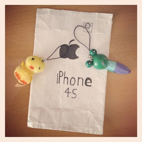 Some gifts from my Chinese students! A ducky keychain, a frog keychain which turns into a pen, and a new iPhone 4S!