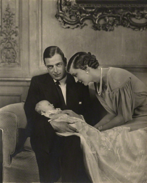 "milstil:  Prince George, Duke of Kent (1902-1942), that wonderful bisexual, adulterous, substance dependendent bon-vivant. We owe the 'Kent style' double breasted to this man, the four button double breasted suit, of which you only do up the last button. I for one think he was much more stylish than his overhyped brother David, better known as the Duke of Windsor. George's style was as subdued and understated as his bedroom exploits were on the edge. Click to enlarge, look 'n' learn.  ""Yeah, my baby's cute and all, but you'll get yours, cameraman."""