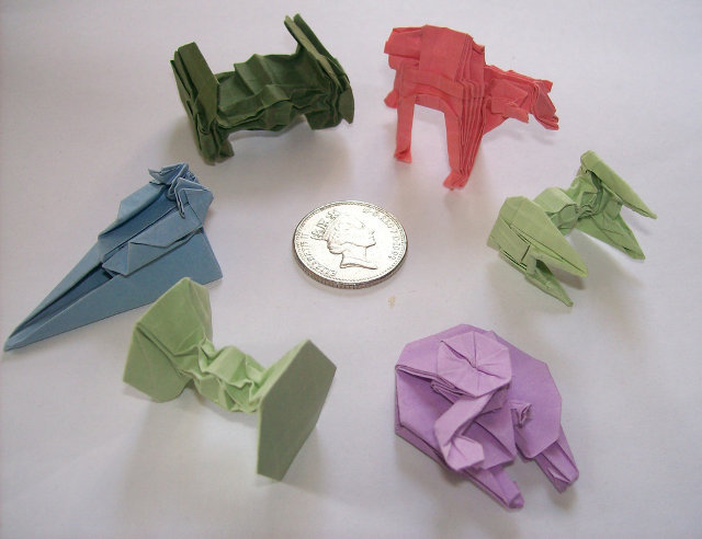 archiemcphee:  These awesome pieces of Star Wars themed origami were created by Martin Hunt, who hopes to obtain the licensing rights from Disney in order to have his original designs published in book form. Then we can all learn how to fold single pieces of paper into Star Wars vehicles, which sounds like a pretty fantastic way to pass the time or impress people at parties. Being able to create R2-D2 using a piece of paper sounds like a skill that belongs on a résumé. Visit the Starwarigami website to view even more of Martin's wonderfully geeky paper craft. [via Geekologie]