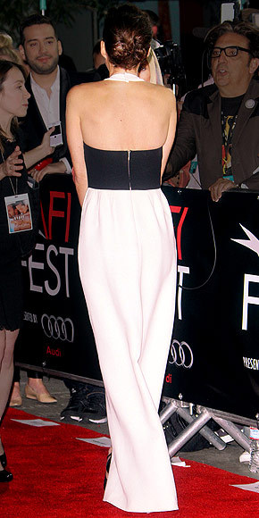 Better From The Back? Marion Cotillard The French actress wears yet another Dior creation — this time a cream-and-black gown. Check out the front of the dress here.