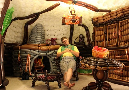 hmhbooks:  thedailywhat:  J.R.R Tolkien Fan Builds a Hobbit Hole with 2,600 Balloons: In celebrating the upcoming release of The Hobbit, Utah-based Balloon artist Jeremy Telford turned his family living room into an authentic hobbit hole using 2,600 hand-pumped balloons over three days in about 40 hours of work. If you're curious about the process, be sure to check out the behind-the-scenes video!  Well, what have YOU done today?  WHOA.