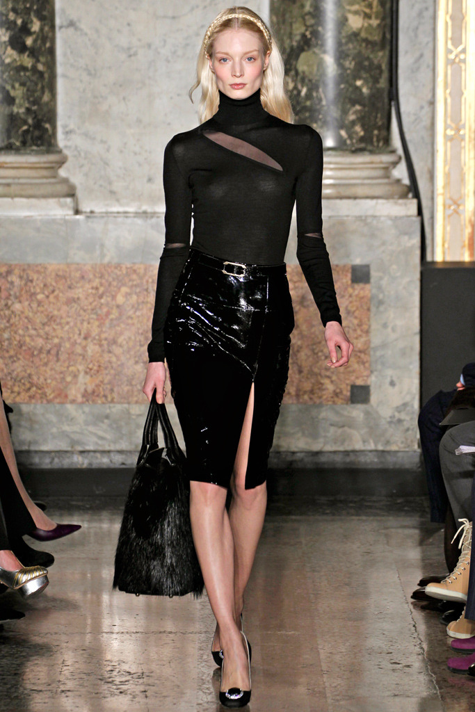 The leather skirt is shiny but isn't it delicious just the same.The slit is the perfect length to let people know - A) Yes, I do take a 6am spinning class B) Yes, I did turn down the role as a bond girl.  Emilio Pucci Photos courtesy: Style.com