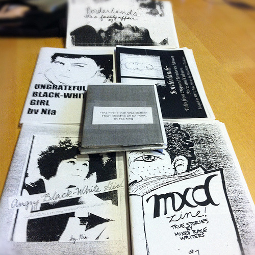 "ZINESTER SPOTLIGHT: Nia King POC Zine Project founder Daniela Capistrano met Nia in person - for the first time - on November 9, while working in San Francisco. It was fortuitous, because just a week or two prior, Daniela ordered Nia's back catalogue of zines for the POC Zine Project archive directly from Nia. Nia and Daniela had a great conversation about the historical context of zines by POC, the role of POC Zine Project and materiality as a catalyst for activism and building community. Some of this discussion will appear in an interview for Colorlines.com in the coming weeks. Here are excepts from the letter that Nia mailed Daniela with the zine order:  …I am working on something for the Mixed-Race Queer Feminist zine. I also submitted a revised/improved version of ""The First 7-Inch Was Better"" for the ""Punk Anterior"" issue of Women and Performance: a Journal of Feminist Theory. It should be coming out any day now. …I just wanted to say that I really respect the work you are doing, and I wish there had been a resource like POC Zine Project when I was a young zinester.  We <3 you, Nia! Thanks for everything that you do. We look forward to collaborating with you on the 2013 Southwest/West Coast Race Riot! Tour! ABOUT NIA Nia King is a mixed-race artist, activist, writer, and filmmaker from Boston, MA who is proud to call Oakland home. She currently writes for Colorlines.com, a national racial justice news website. Before joining Colorlines, Nia worked to improve the quality of life of queer and transgender students of color at Mills College by organizing a number of educational, political, and social events for the campus community. Before moving to Oakland, Nia served as a Grassroots Fundraising Specialist and Crisis Hotline Volunteer at the Colorado Anti-Violence Program, a nonprofit which works to end violence within and against Colorado's LGBTQ communities. In addition to her nonprofit work, Nia has spend the last five years self-publishing, presenting at conferences, and screening her film, ""The Craigslist Chronicles."" Her writing has been published in Zine Yearbook 9, Race Revolt Magazine, and the book Zines in Third Space: Radical Cooperation and Borderlands Rhetoric. More of her writing is soon to be published in Women and Performance: A Journal of Feminist Theory. Nia has presented her undergraduate research project, ""Mangos with Chili: Life-Sustaining Performance Art for and by Queer and Transgender People of Color,"" at Stanford University, UC Riverside, and the University of Arizona. Her most recent project, a short comedic film about apartment hunting in Oakland, premiered at the 2012 National Queer Arts Festival in San Francisco, and recently had its international premiere at the Trans Film Screening Series at the University of Toronto's Center for Women & Trans People. You can contact Nia directly at niaking@zoho.com. COMMUNITY: You can access many of Nia's zines for free on QZAP.org, as well as order them from Stranger Danger Distro. Here's a taste: The 7-Inch was Better: How I Became and Ex-Punk (online at QZAP)  ""Nia (Angry Black-White Girl and Borderlands) comes forward to declare her status as an ex-punk. She criticizes anarcho-punk and many activist scenes for its ignorance and the lack of inclusion of folks of color, women and queers. Nia refuses to leave a part of herself at the door in order to adjust to the whiteness and maleness of a musical scene that she once truly enjoyed. The zine also includes a pull-out portion in which you can take along to your next show in order to challenge yourself, your friends and other bystanders."" - quoted from StrangerDangerDistro.com"