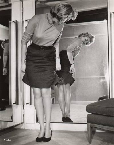 louismazzini:  Lana Turner, the original sweater girl, checks her stockings.