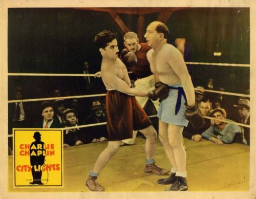 "chaplinfortheages:  Lobby Card for ""CITY LIGHTS"" - 1931 This was just 5 minutes of brilliantly executed choreography - when the bell goes off he surprises you with his perserverence (that being, trying not to get his ass kicked) - one of the funniest scenes in the film and next to the end my favorite.  I laugh every time I watch it"