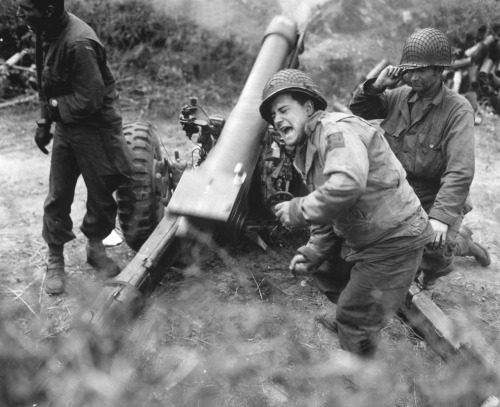 collective-history:  American howitzers shell German forces retreating near Carentan, France. July 11, 1944