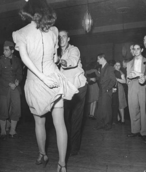 allaboutthepast:  A young man swings with his date, 1940s