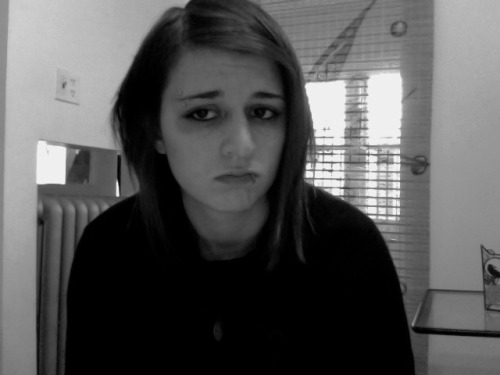 me frowning in black and white because i hate being an adult