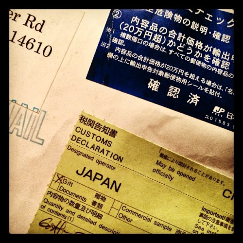 SUSPICIOUS JAPANESE PARCEL: current status and new fake band name. (at Delgrossocorp HQ)