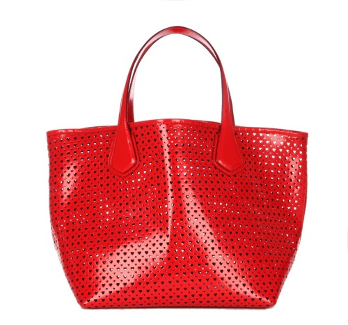 Nothing better than a bright red bag on a grey winter day. This cutout heart tote ($295) will hit mzwallace.com in January.