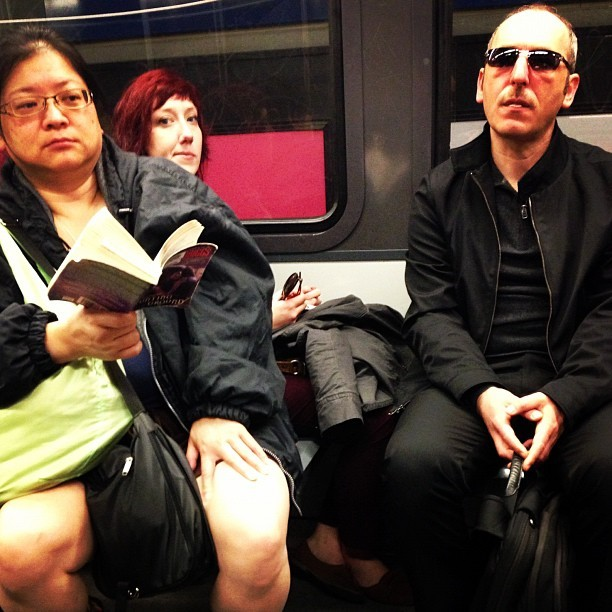 The trio on the L. #muni #sf #sanfrancisco #passengers #transit #sunglasses #reading #red