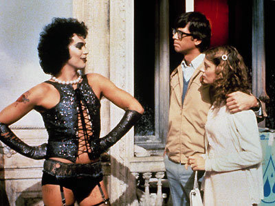 In honor of the upcoming Wilson showing of Rocky Horror Picture Show (Saturday, the 17th at 7pm in Bryson Gym) we are sharing some tips for all the 'virgins' planning on giving themselves over to absolute pleasure that evening. Tips for Virgins! Audience Participation is a part of the show and started back in the 1970's in the USA and made it over to the UK a few years later. Fans have been dressing up, shouting back lines and singing along to the show and movie for thirty years now. The Wilson performing cast will act out the movie in front of the screen. Audience Participation should always be complementary to the show, never just shouting out lines for the hell of it. The following two responses will get you started in the wonderful world of talk-back. Brad is referred to as an 'Asshole', when his name is mentioned in the dialogue by the Narrator this is the correct response. Janet on the other hand is referred to as a 'Slut'. The idea of Rocky Horror Participation is to have fun but be mindful of the cast and other audience members. Doing so will allow you to the show to the maximum pleasure level. When it Comes to Props The throwing of rice, water, etc. is meant to be fun and should not cause damage to the Bryson or other people's costumes. Moderation can be a key element, a light shower rather than a monsoon! The following items may be of use to you during the show.Please note that it is considered very bad etiquette to throw anything onto the stage, not to mention dangerous for the actors. Rice, to be thrown during the wedding scene. Toast, thrown during the dinner scene. Rubber gloves,to be snapped in time with frank 'n' furter during the creation scene. Flashlight, used during the song 'there's a light'. Party Poppers etc, used during the Dinner/Happy Birthday scene in the play. Newspaper, worn over the head during the rain scene. Playing Cards, thrown during the line 'cards for sorrow, cards for pain'. Overall, please listen to the cast as far as seating in Bryson, dress up like its Halloween all over again, participate and if you're a virgin (i.e someone who has never been to a Rocky Horror Show before) be prepared for lipstick on your face. For more Rocky Horror virgin tips, just go ahead and google it. There are a million sites that will give you even more specific information. See you on Saturday!