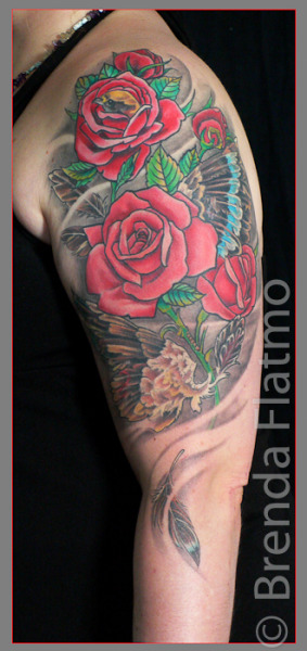 Bird and rose fantasy tattoo done by Brenda Flatmo at PluraBella in Cincinnati, Ohio.