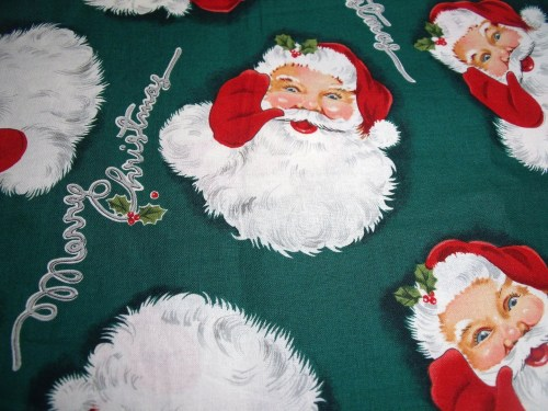Vintage style Santa fabric.  His eyes look kind of crazy!  I'm thinking of making Santa head ornaments with embroidered embellishment.