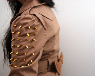 Spiked Bow Trench Coat | Studs & Pearls So it seems that the spikes trend is not going anywhere, and I for one am happy about that! I love how they give a traditional jacket a tough makeover, yet the lovely little bow on the back adds sweetness too.