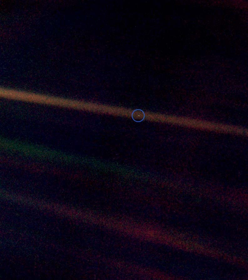 "Pale Blue dot Seen from about 6 billion kilometers (3.7 billion miles), Earth appears as a tiny dot (the blueish-white speck approximately halfway down the brown band to the right) within the darkness of deep space. Sagan pointed out that ""all of human history has happened on that tiny pixel (shown here inside a blue circle), which is our only home"" (speech at Cornell University, October 13, 1994.) via: wiki"