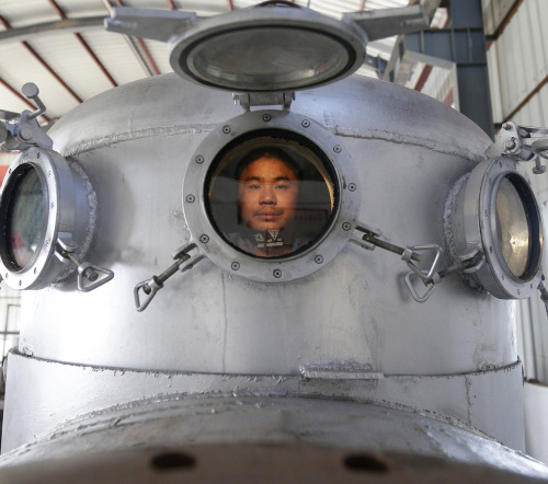 guardian:  Zhang Wuyi sits in his newly made multi-seater submarine at his new workshop in Wuhan, China. Zhang, a local farmer, has made seven miniature submarines with several fellow engineers, one of which was sold to a businessman for $15,855. The submarines, mainly designed for harvesting aquatic products, such as sea cucumber, have a diving depth of 20-30 metres.  From picture desk: live, our place for the day's best news images. Photograph: Darley Shen/Reuters