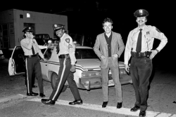 "delivermefromnowhere:   Bruce Springsteen, pulled over by New Jersey police officers for speeding on Route 9 a cool nitetop downfrom manhattan to holmdaleradio blastingrod stewart singin' ""Tonight's the Night""drivin' fast down route 9breaking the lawsirenspulled oversurprisesnap pop snap poppics with the bossno tickethappy endingfond memories—L.G.  Lynn Goldsmith's contribution to Photographers For Sandy Relief."