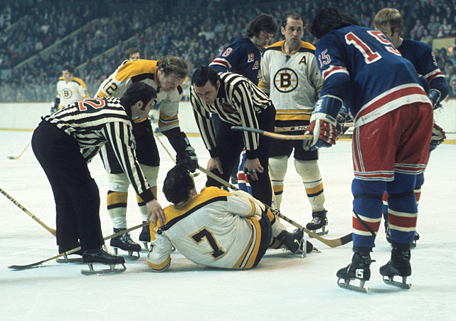 Phil Esposito lays on the ice after injuring his knee during a 1973 Bruins-Rangers playoff game. (Tony Triolo/SI) GALLERY: Classic Photos of the Boston Bruins