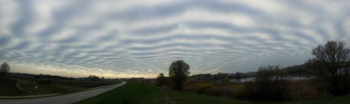 This is what the sky looked during my bicycle training today. At first I thought my glasses were fogged creating some kind of polarisation effect - but it was real. Took some pics with my cell phone and stitched them. Greetings from Hamburg!