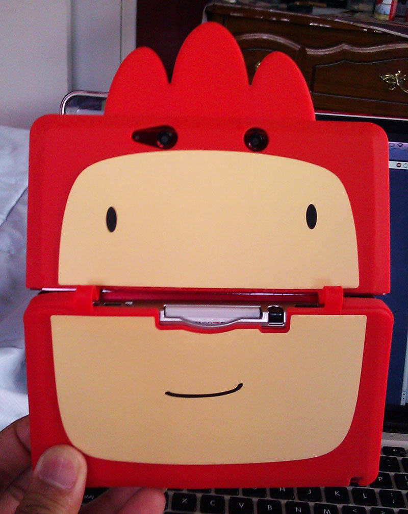 Here's that Scribblenauts Unlimited 3DS case up close. The 3DS version of the game shipped out this week, and those who preordered it at GameStop received a rooster hat, a pencil stylus, and a silicon case for their handhelds — sorry XL owners, this one's only for the standard 3DS. Scribblenauts Unlimited hits Wii U this weekend without any extras unless you count the Nintendo characters. Buy:& Super Scribblenauts, Scribblenauts UnlimitedSee also: More Scribblenauts Unlimited news and media[Via Eric]