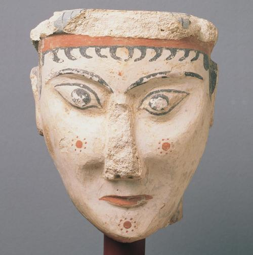 Head of a woman (or a sphinx?), painted plaster. Mycenae, Greece. 1300-1200 B.C. (Late Mycenaean) [National Archaeological Museum of Athens]