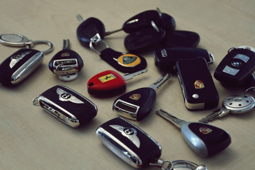 johnny-escobar:  Bentley, Porsche, Ferrari, Lotus, BMW, Audi, & Pagani…but no Lambo keys O.o